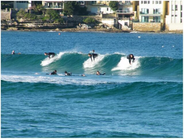 Three Surfers